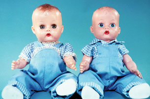 Ginnette and brother Jimmy (1958) wear matching blue broadcloth overalls and blue-and-white checked shirts: You can tell it's Ginnette by the ruffles on her sleeves and overalls.
