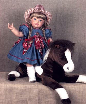 ": Giddyup, pardner! ""Calamity""—all 26 inches of her—is riding high on her favorite fuzzy steed. She's decked out with a cowboy hat and boots, plus a denim dress trimmed with bandanna-print triangles on the skirt, sleeves and bodice; each triangle sports a silver concho. From this edition of 100, ""Calamity"" can be purchased solo for $290 or for $355 with her horse."