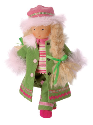 """The """"Mini It's Me"""" Winter Child is 10 inches tall and priced at $59. The doll is dressed in a green corduroy outfit, trimmed with fur. Her hem is decorated with two rows of lace. The Winter Child is a Waldorf Doll."""