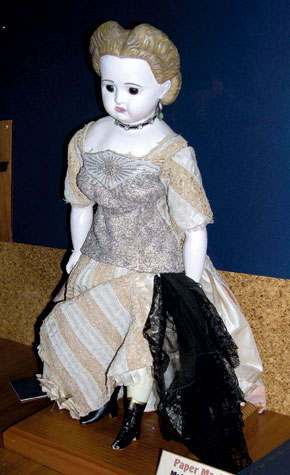 This papier-mâché/wax doll, circa 1890, is by an unknown maker.