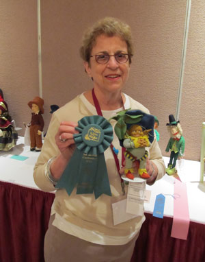 Elaine Romberg won the Best of Show ribbon in the Competitive Exhibit for her exceptional Lenci Leprechaun Gnome type character doll.