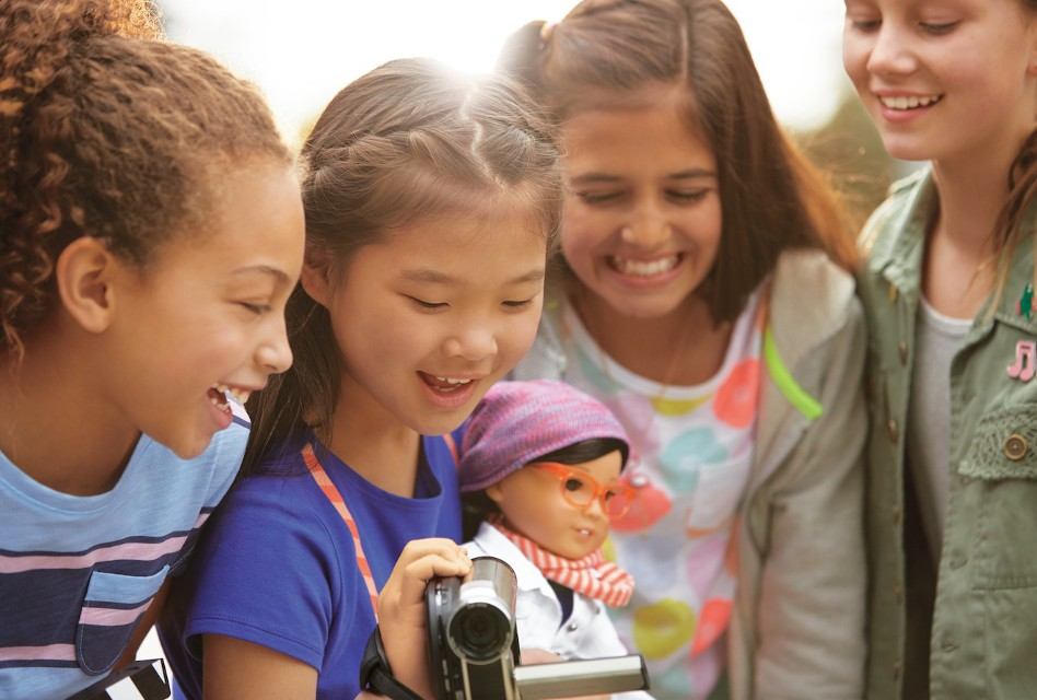 American Girl's Z Yang doll surrounded by real American girls.