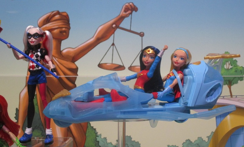 """Wonder Woman takes to the sky, in her """"invisible"""" plane from Mattel."""