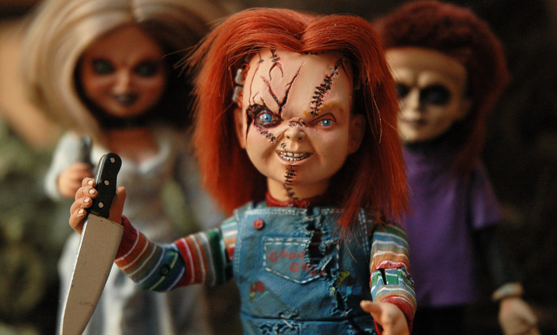 Chucky, one of the most famous doll villains, wields a knife.