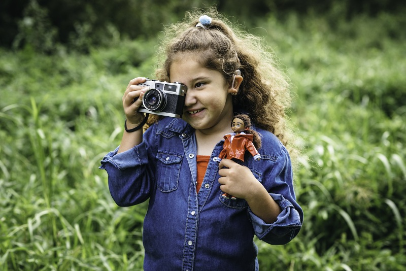 The Wildlife Photographer at play, both as doll and as child shutterbug