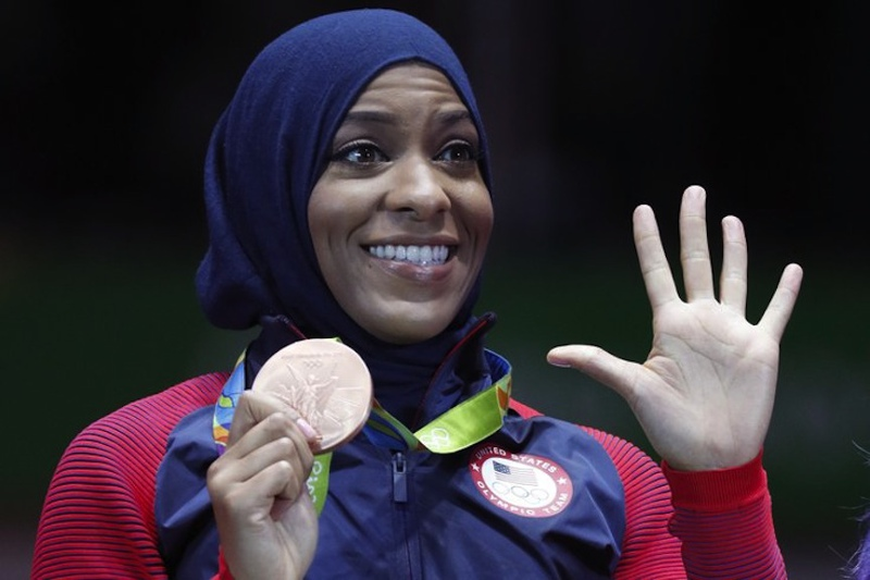 In Rio 2016, making history and receiving her team bronze medal. Photo courtesy Ibtihaj Muhammad Twitter Account