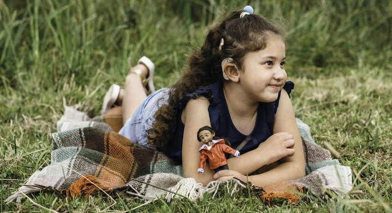 A girl with a cochlear implant has a doll that reflects her reality, from Lottie Dolls.