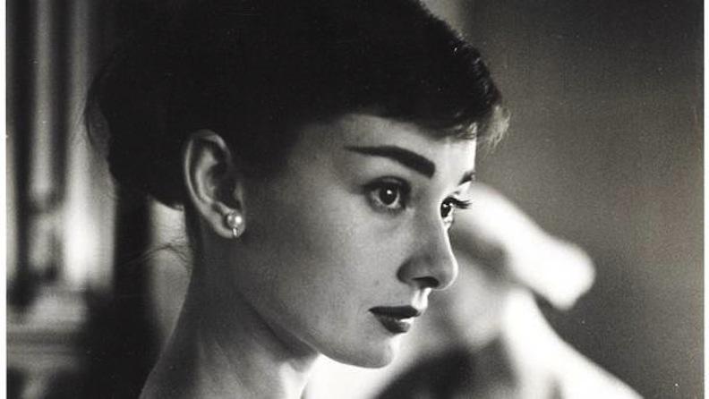 Audrey Hepburn wearing pearl earrings