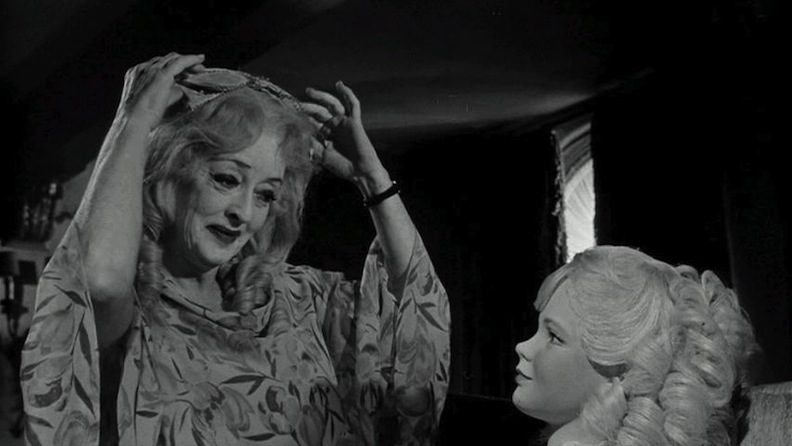 "Bette Davis and doll in ""What Ever Happened to Baby Jane?"""