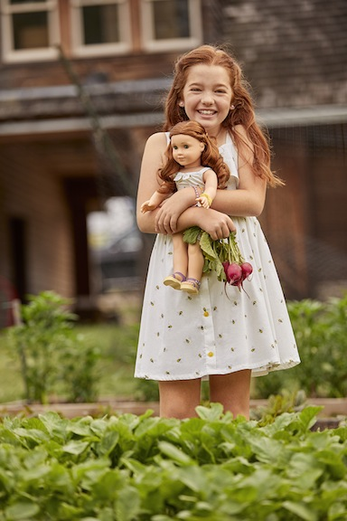 Young girl and Blaire Girl of the Year doll