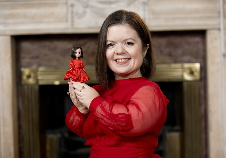 Author and activist Sinéad Burke poses with her likeness, the Sinéad Burke doll from Lottie Dolls. Photo Fennell Photography 2019