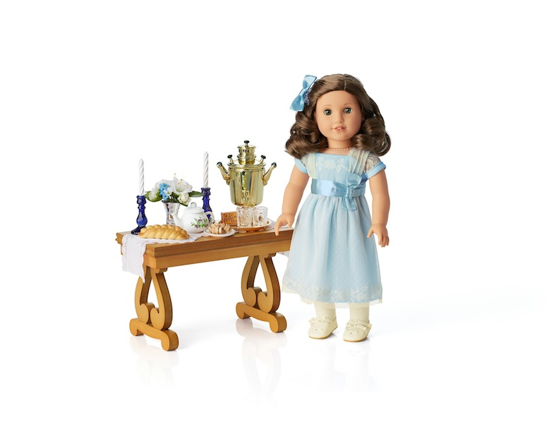 Scaled for 18-inch dolls, American Girl's Rebecca's Sabbath Set and Parlor Table are lovely possibilities for a Hanukkah gift exchange.