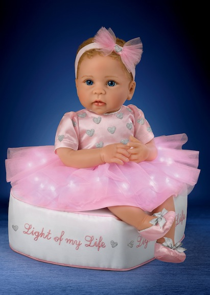 Light of My Life does just that, literally and figuratively. The Ashton-Drake charmer is an adorable baby doll, and her skirt physically lights up.