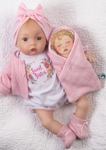 Sweet Sister from Paradise Galleries wears a turban and has her own little cloth baby doll. She exudes Old Hollywood glamour, infant style.