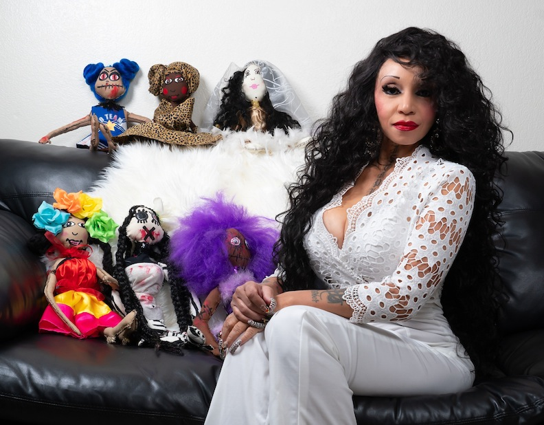 Exstasie Harvey and a few of her frightfully different dolls