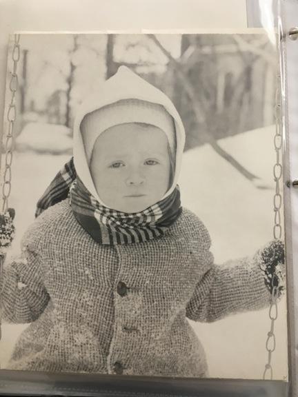 Elizabeth Cooper as a little girl, enjoying the snow.