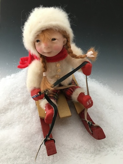 Many of Cooper's dolls mirror her own childhood memories and activities. This Winter Series doll resembles the artist's own winter wardrobe.