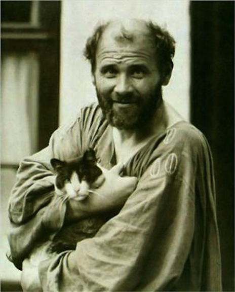 Gustav Klimt and his favorite cat, Katze. Katze was a mischief-maker and would distract his models and cause chaos in the studio.