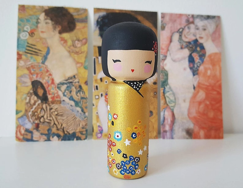"AngelatinosaArt created this stunning Kokeshi peg doll to honor Gustav Klimt and his legacy of ""The Kiss."""