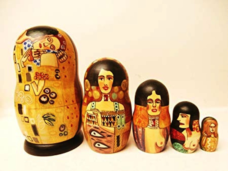 These hand-painted Klimt nesting dolls hail from the workshop of A. Shoshin and Alkota. They are made of basswood and feature acrylic paint.