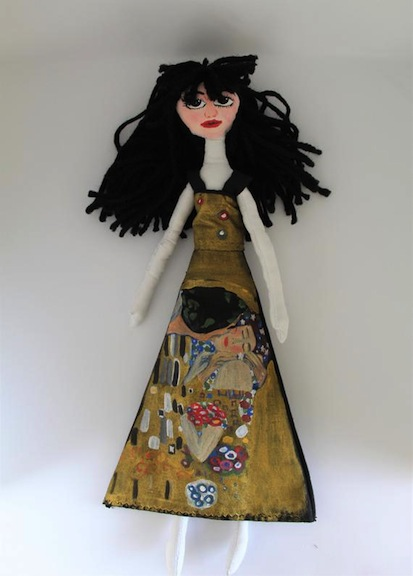 "Eleonor Arte fashioned this cloth and fabric doll paying homage to ""The Kiss."""