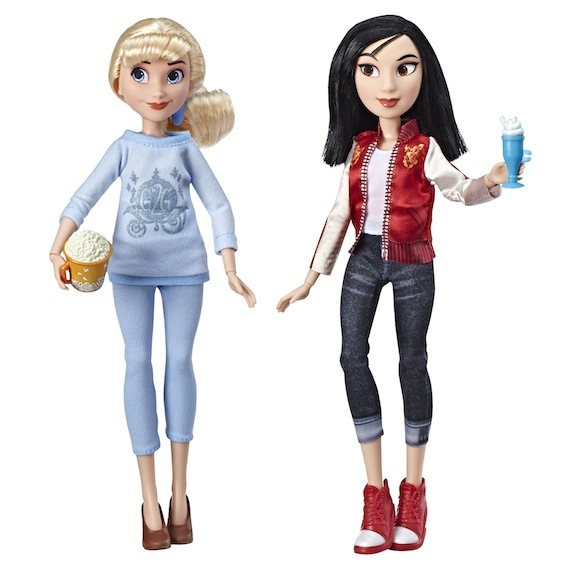 "Cinderella and Mulan in modern outfits, part of Hasbro's ""Ralph Breaks the Internet"" line of dolls."