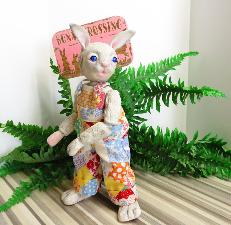 One of Moulton's latest works, Briar is an 11-inch BJD bunny and one of Moulton's latest works. His patchwork overalls were made by Moulton.