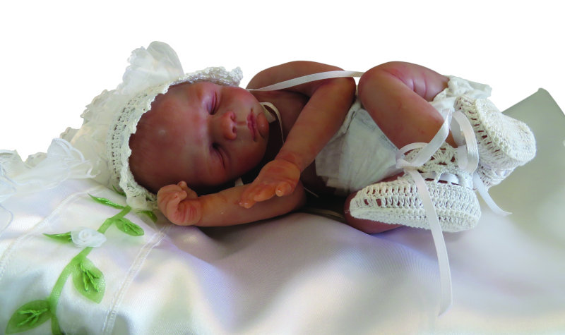 """Moulton has a deep attachment to this OOAK baby named Brook. """"She went to a private collector after a lot of back-and-forth asking me to sell her. There are not many dolls you have such a strong connection to that you sculpt. It was hard for me to let her go. She has won a few awards."""""""