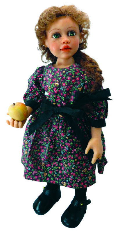 """""""About 17 years ago I made this doll with oven-baked clay. We didn't have the resin back then to make our dolls or any contacts overseas to make them. I made her clothing and even her apple. It was fun,"""" Moulton said."""