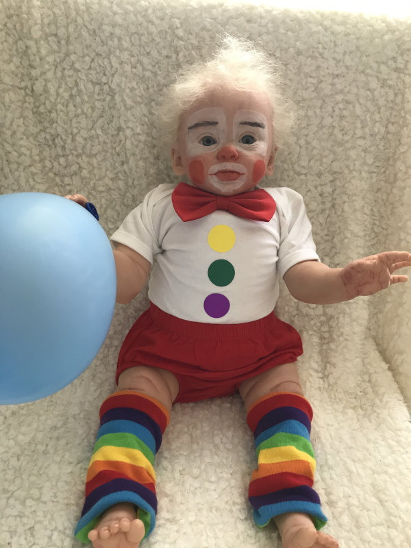 Charlie is Marita Winters' limited-edition vinyl Princess Adelaide remade as a colorful clown in an outfit from Lil Peanut Designs.