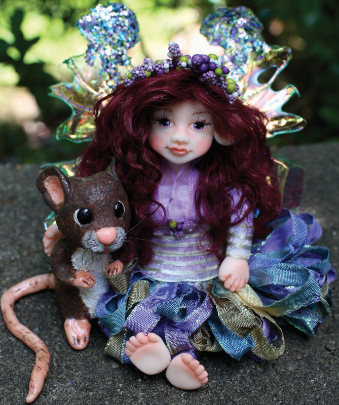 Viola, a lovely 5.5-inch fairy doll, with Lotty, her animal companion.