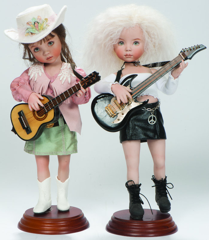 Little Bit Country and Little Bit Rock and Roll were souvenir and companion dolls for a meal event at the 2007 United Federation of Doll Clubs (UFDC) convention. The 12-inch all-porcelain dolls were costumed by Nedra Newson and Lana Dobbs. Dolls were made in the studios of Dianna Effner and several Doll Dreamers Guild members.