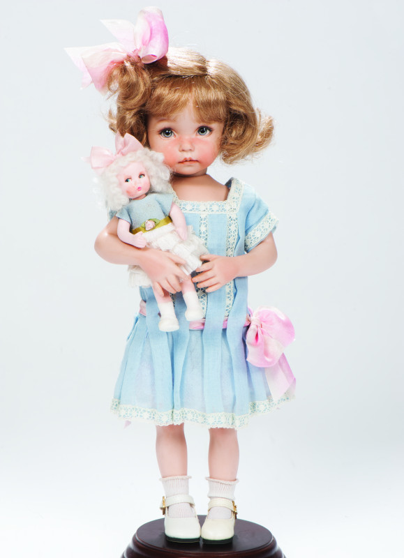 Costumed by Nedra Newson, Little Lou is an 11-inch all-porcelain doll.