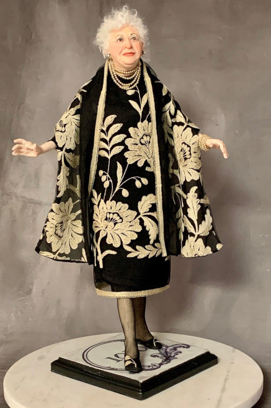 """""""Mrs. K"""" Does the Town is a 23-inch polymer-clay portrait doll of a client's mother, made for her 90th birthday celebration. She's dressed in antique French lace and black Italian silk with antique seed pearls."""