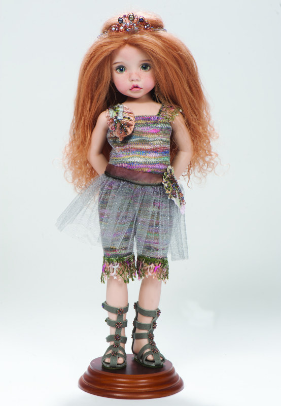 Sprite is a 12-inch all-porcelain OOAK. The doll's costume is by Nedra Newson.