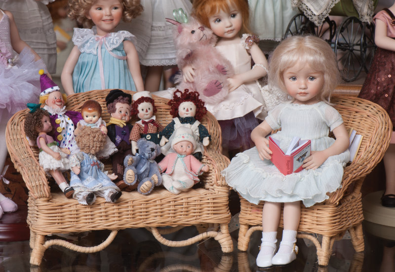 A scene from the studio shop in Jamestown, Mo. Allison, an 11-inch all-porcelain doll, reads a story to a group of miniature dolls.
