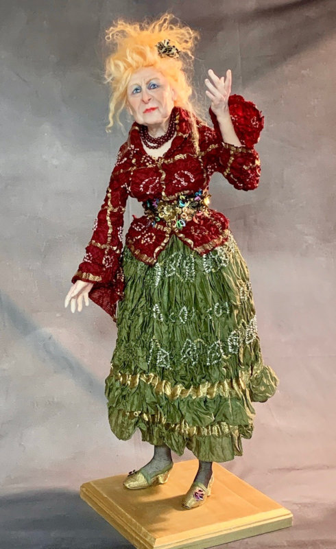 Vivienne: Age Is Just a Number is a 23-inch polymer-clay OOAK painted with fine acrylics and pastels, with Tibetan mohair and silk clothes.