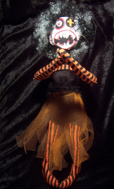 Ms. Orange is a dramatic addition to Harvey's Creepy Dolls.