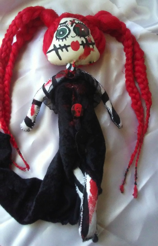 The 14-inch Red Head Zombie is part of Harvey's Creepy Doll line.