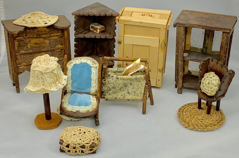 """Manuela Sanchez enjoyed creating wooden miniatures. """"Everything in this photo was made by her, from the wood carving to the needlework,"""" Robinson said."""
