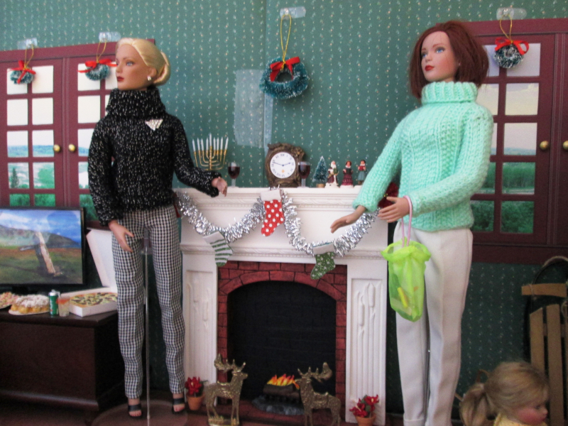 "Carol Quantock: ""These Tonner girls are enjoying their holiday house party with their families. Note the menorah on the mantelpiece as well as the tiny carolers. There's pizza, wine, soda, cookies, and cake for the guests."""