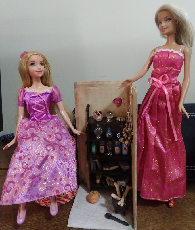 """Daisy Regina Ferraz Carpi de Andrade Lima: """"I made a miniature witch's bookcase and the Barbies posed in their trick-or-treat dresses."""""""