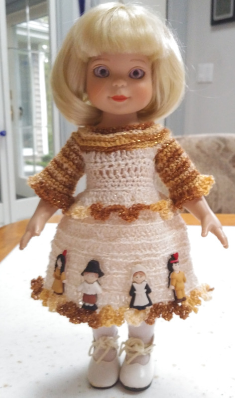 "Sandy Halstead: ""A friend wanted a Thanksgiving dress for her Tonner Linda McCall Doll. I designed and crocheted this dress for her doll using lace-weight yarn in fall colors, decorated with Pilgrim buttons."""