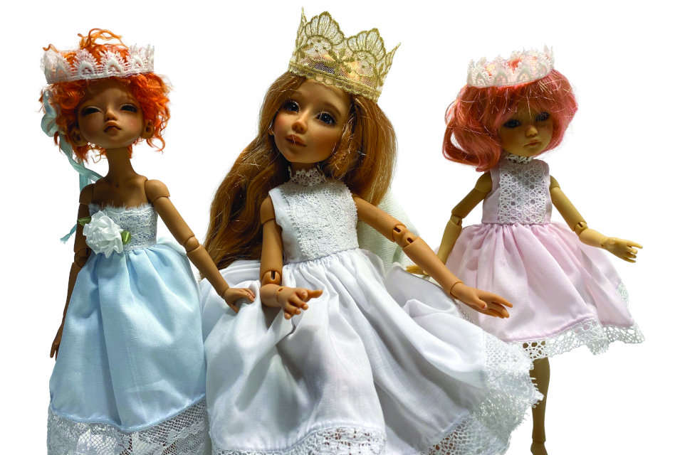 Rose Lacefield's Jemima, Abrielle, and Winnie showcase Schmidt's regal clothing styles.