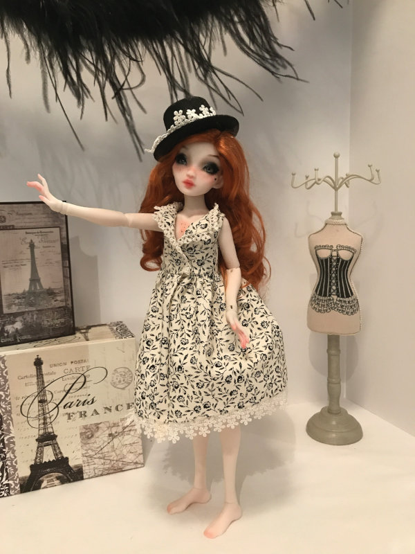Pidgin looks elegant in her Schmidt garments. The Joshua McKenney doll features a special OOAK faceup.