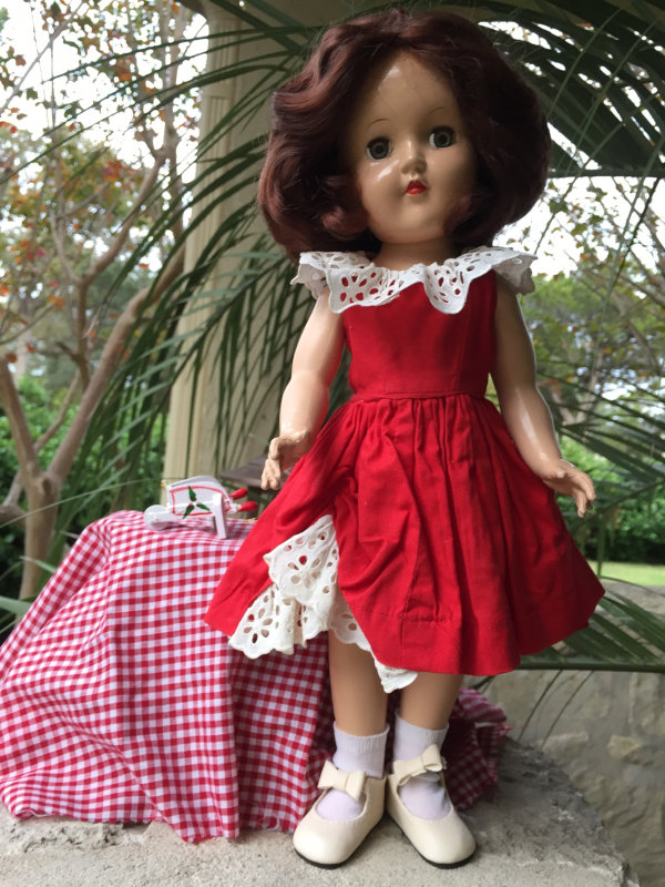 "Rose Engelhardt: ""Ideal's Tony doll. She is attending a Christmas patio party."""