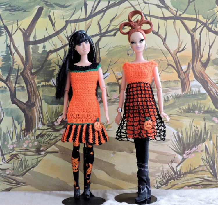 """Sandy Halstead: """"My Barbie dolls are modeling Halloween dresses I designed and crocheted for them in lace-weight yarn, decorated with sparkly pumpkin buttons!"""""""