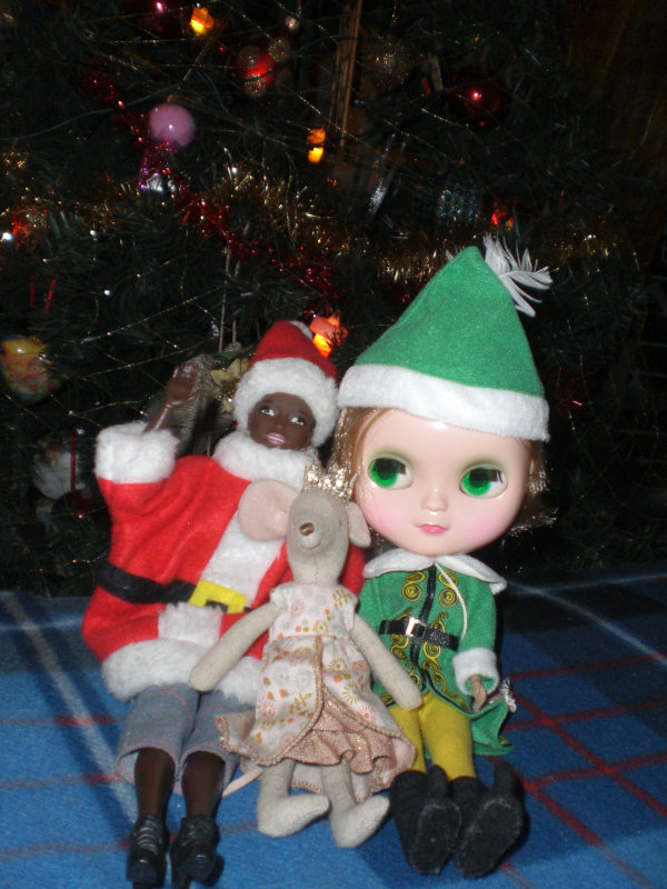 "Sara Ahmed: ""Hi! My name is Sara, I'm 28 years old and I'm from Italy. In this pic there are two of my dolls: my Icy doll Anne and my Barbie Made to Move. There is also a mouse of Maileg, a Danish brand. She is so cute and she is a princess. In the background there is my Christmas tree. With all these different characters I want to spread a message of diversity, and also everyone can feel happy and celebrate Christmas."""