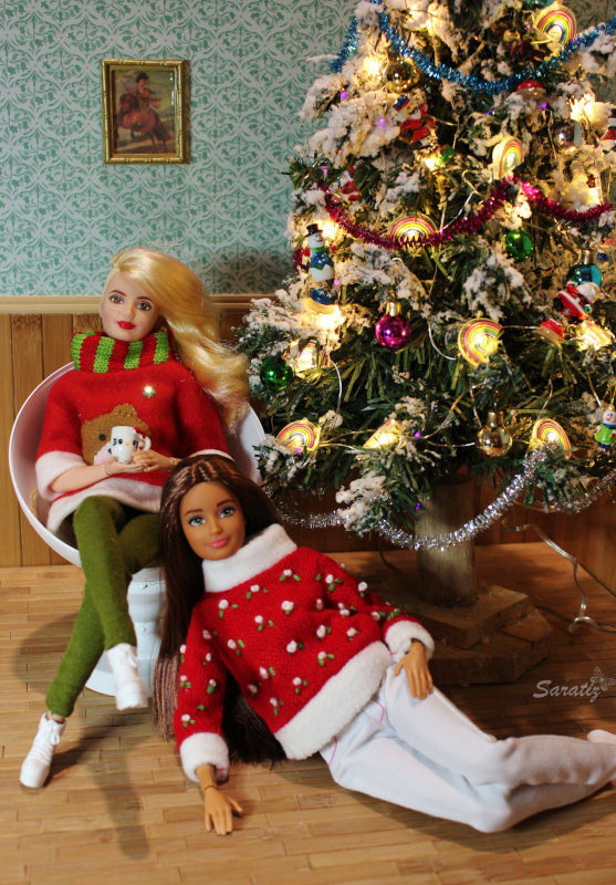 "Sara Massa: ""Annie and Natalie (Barbie Fashionistas on MTM bodies) celebrate their Christmas under the tree wearing their favorite Christmas sweaters."""