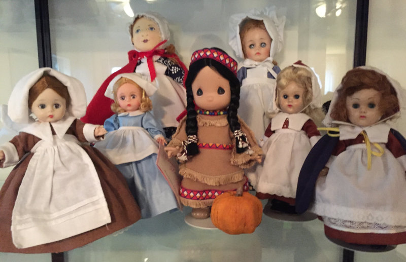 "Linda Shypulefski: ""Pilgrims are a bent-knee Alexander in a Ginny costume. Blonde Alex is called 'Pilgrim.' Cloth doll from Williamsburg; 12-inch Nancy Drew face Alex in a Royal Dolls outfit. Vintage Ginny dolls wear Ginny outfits. They're enjoying Thanksgiving with a Precious Moments Indian."""